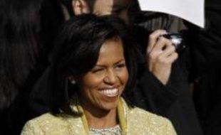 """Michelle Obama, la """"première Première Dame noire"""" des Etats-Unis, a grandi dans les faubourgs pauvres de Chicago (nord), où cette brillante juriste a vécu de près les inégalités de la société américaine."""