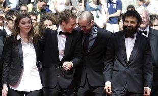 """Clara Royer, Laszlo Nemes, Matyas Erdely et Geza Rohrig à leur arrivée pour la projection de leur film """"Le Fils de Saul"""" le 15 mai 2015 à Cannes"""