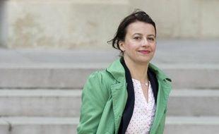 Cécile Duflot quitte l'Elysée, à Paris, le 26 mars 2014