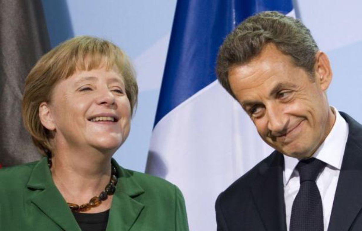 Une rencontre entre Mme Merkel, M. Sarkozy et les dirigeants de l'Union européenne et du Fonds monétaire international est prévue mercredi à Cannes. Elle sera suivie d'une autre rencontre avec la Grèce, a ajouté l'Elysée. – Johannes Eisele afp.com