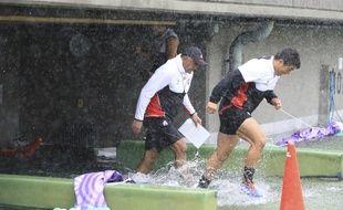 L'équipe du Japon et son sélectionneu Jamie Joseph à l'entraînement à Tokyo vendredi, deux jours avant le match contre l'Ecosse, menacé par le typhon Hagibis.