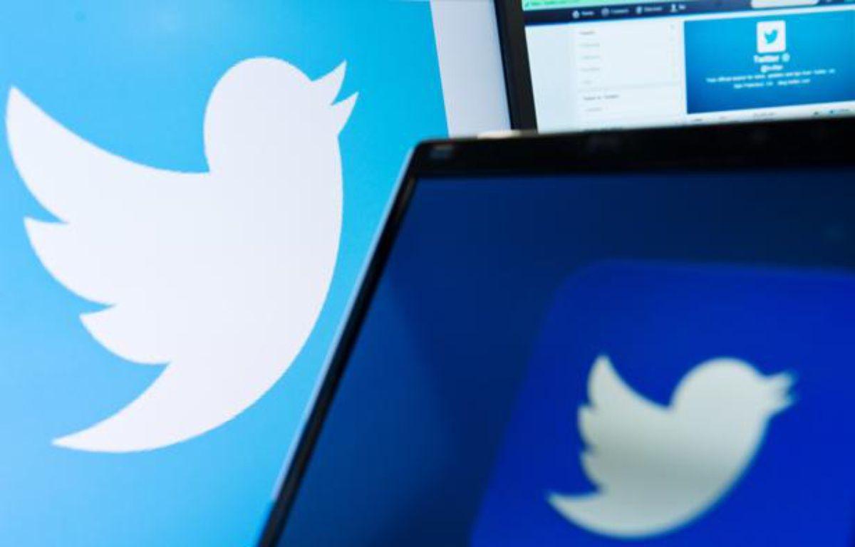 Illustration: Le logo de Twitter sur plusieurs écrans, septembre 2013. – Leon Neal / AFP