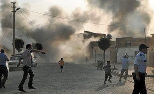 Panique après un tir de mortier d'origine syrienne à Akçakale, en Turquie.