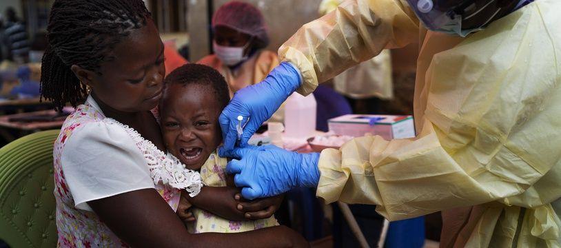 Un enfant se faisant vacciner en RDC contre le virus Ebola, le 13 juillet 2019.