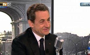 Nicolas Sarkozy, interrogé sur BFMTV et RMC, le 8 mars 2012.