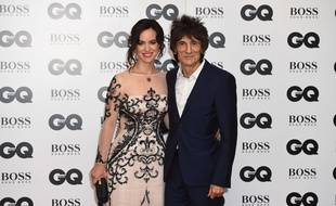 Sally Humphreys and Ronnie Wood pose for photographers upon arrival at the GQ Men of the Year Awards 2015 in central London, Tuesday, Sept. 8, 2015. (Photo by Jonathan Short/Invision/AP)/VDJ120/598396450247/090815112356, 21334631, /1509082047