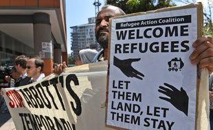 Un manifestant lors d'un rassemblement contre la politique d'immigration australienne, à Sydney, le 26 septembre 2014.
