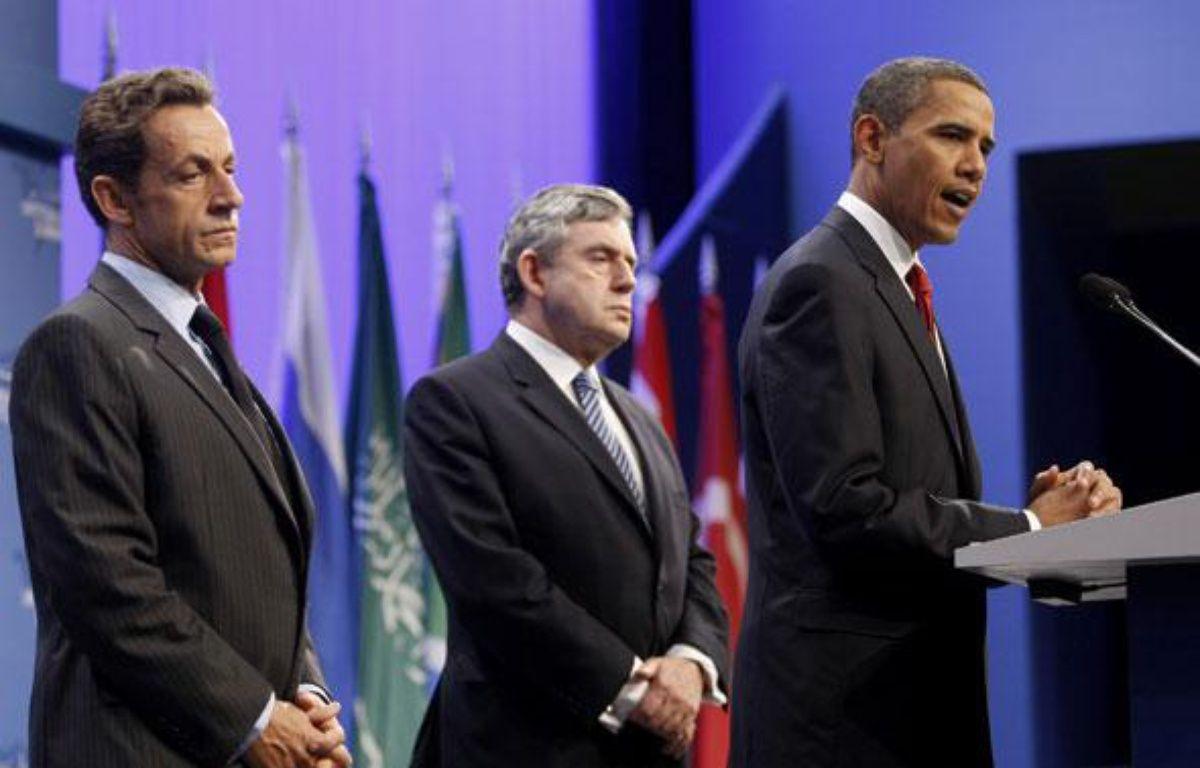 Nicolas Sarkozy, Gordon Brown et Barack Obama lors d'une déclaration conjointe sur l'Iran, à Pittsburgh, vendredi 25 septembre. – REUTERS/Kevin Lamarque