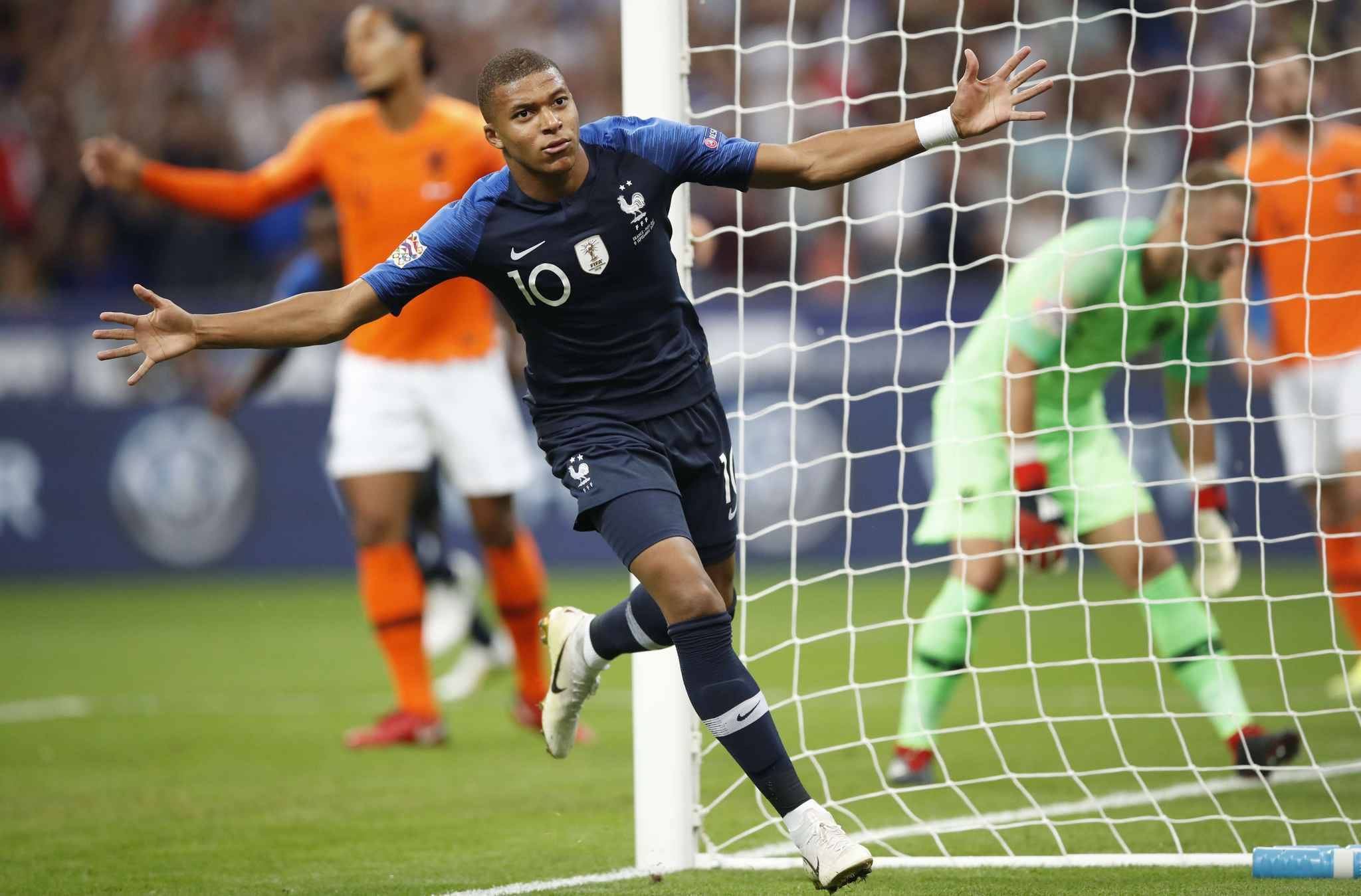 France's Kylian Mbappe celebrates after scored his side's opening goal during the UEFA Nations League soccer match between France and The Netherlands at the Stade de France stadium in Saint-Denis, outside Paris, France, Sunday, Sept. 9, 2018.
