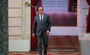 Le Président François Hollande lors de son arrivée à la conférence de presse à l'Elysée lundi 7 septembre 2015.
