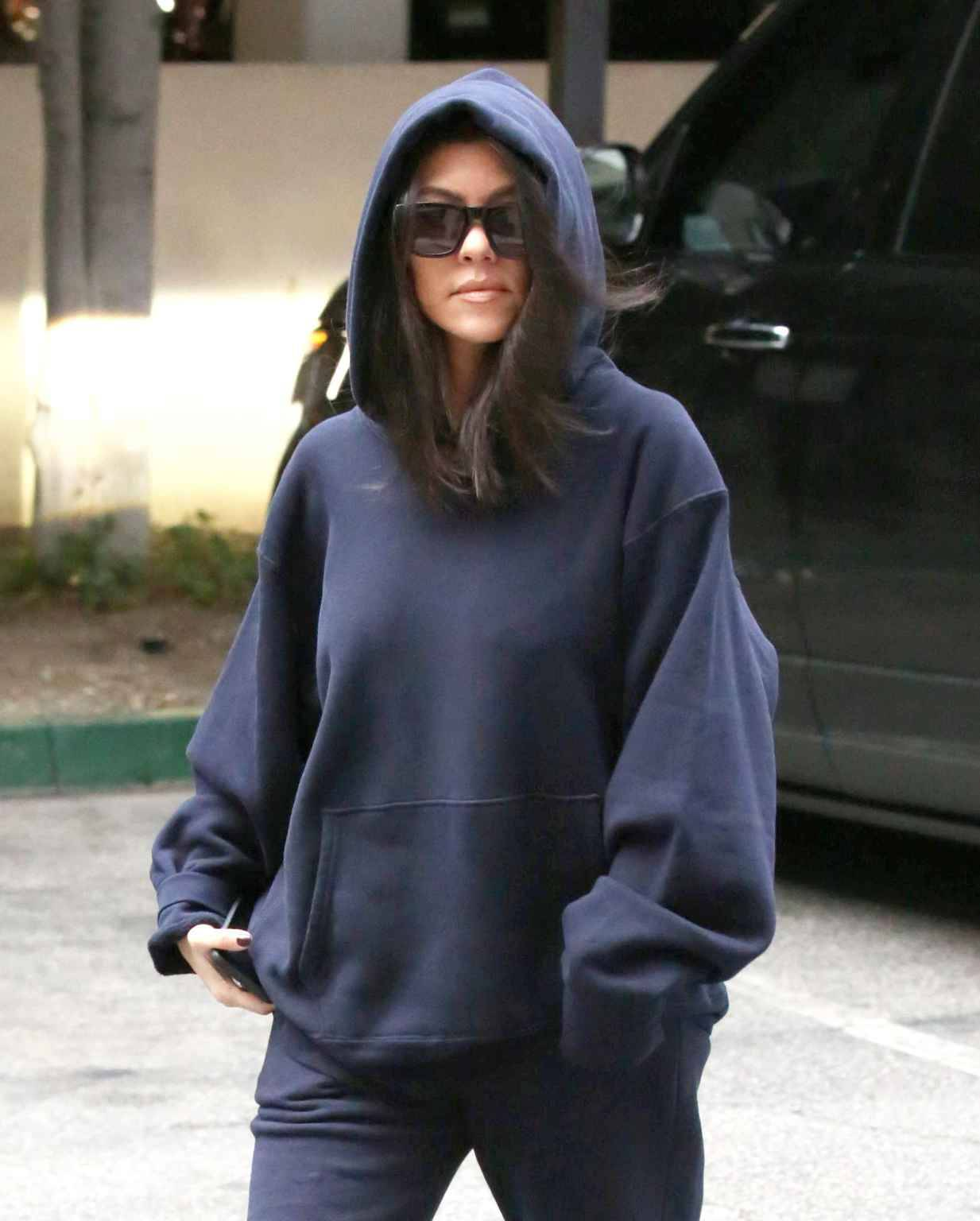 Wednesday, February 20, 2019 - Kourtney Kardashian tries to go under the radar in a navy hoodie and sunglasses as she steps out with son Mason in Calabasas amid Tristan Thompson\'s cheating scandal. The Kardashian Klan is undergoing damage control after Khloe Kardashian\'s NBA baller fiance admitted to cheating on her with Kylie Jenner\'s 21-year-old bestie, Jordyn Woods. 9-year-old Mason must look up to Kylie\'s beau Travis Scott because he was sporting a $185 Travis Scott AstroWorld \'Look Mom I Can Fly