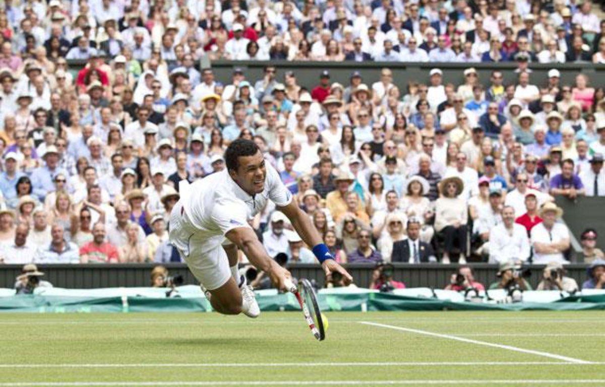 Jo-Wilfried Tsonga lors de quart de finale face à Roger Federer, à Wimbledon, le 29 juin 2011 – REX/SIPA