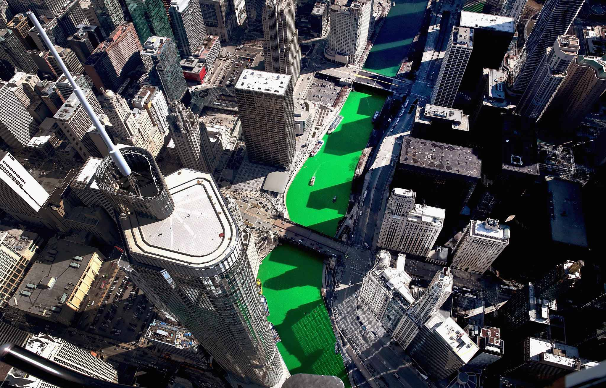 CHICAGO, ILLINOIS - MARCH 16: An aerial view of the Chicago River as it winds its way through downtown after being dyed green in celebration of St. Patrick's day on March 16, 2019 in Chicago, Illinois. Dyeing the river green has been a St. Patrick's Day tradition in the city since 1962.