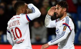 Lyon's French midfielder Nabil Fekir (R) and Lyon's French forward Alexandre Lacazette (L) react after scoring a goal during the French L1 football match between Montpellier and Lyon on March 8, 2015 at the La Mosson Stadium in Montpellier, southern France. AFP PHOTO / PASCAL GUYOT