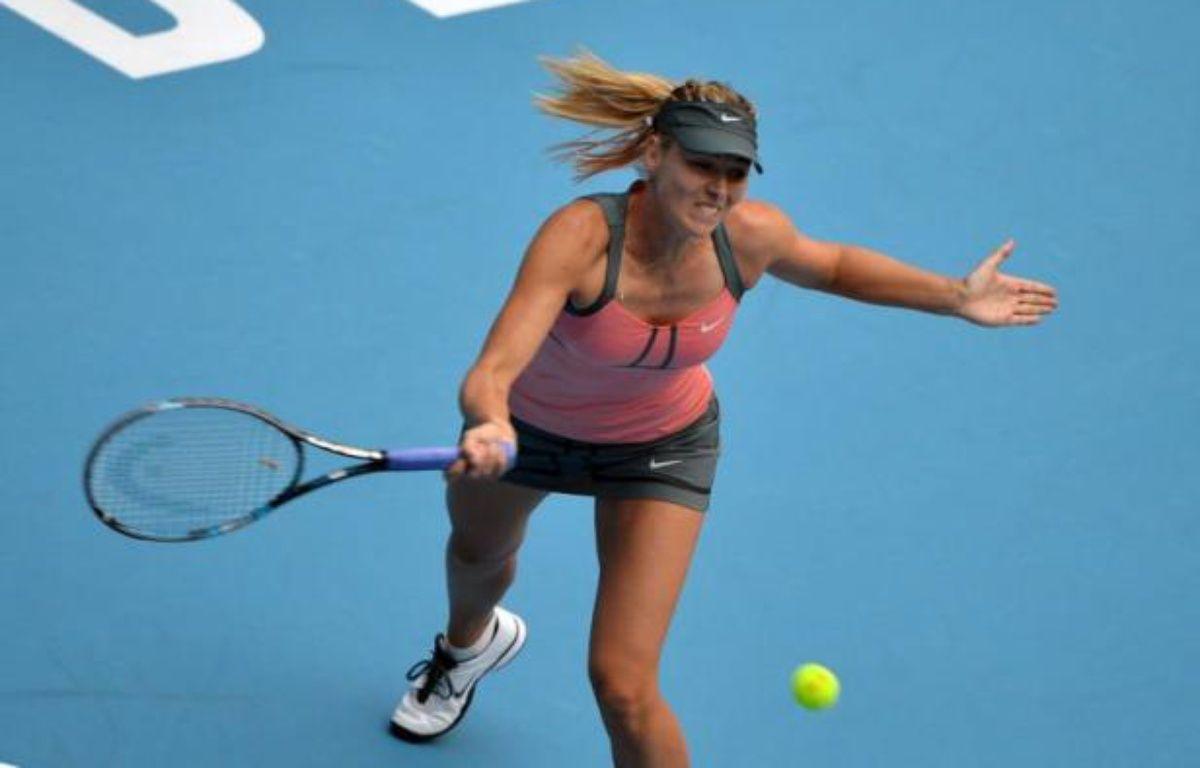 La Russe Maria Sharapova, N.2 mondiale s'est qualifiée pour la finale du tournoi WTA de Pékin en battant en demi-finale la Chinoise Li Na, N.8 mondiale, en deux sets 6-4, 6-0, samedi. – Mark Ralston afp.com