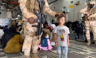 Des réfugiés évacués de Kaboul le 26 août 2021.