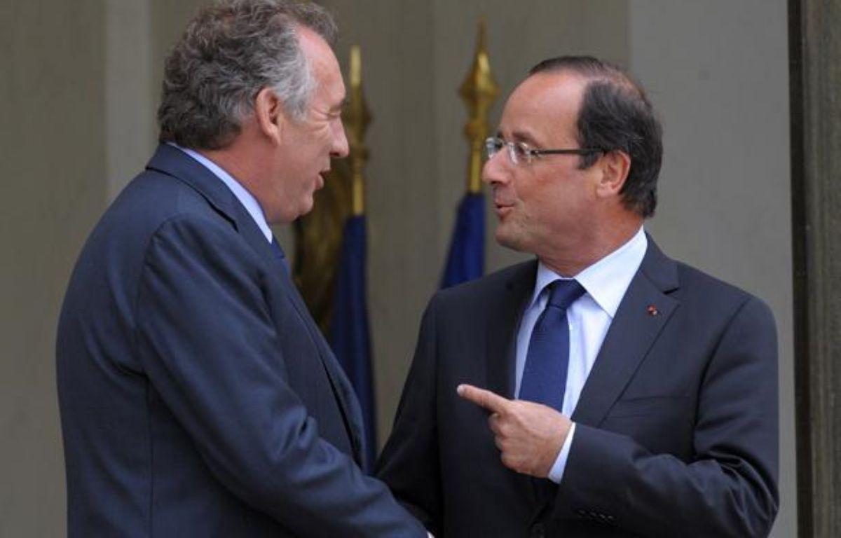 François Bayrou et François Hollande, le 4 juin 2012, à l'Elysée. – P.WOJAZER / REUTERS