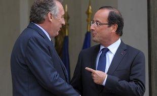 François Bayrou et François Hollande, le 4 juin 2012, à l'Elysée.
