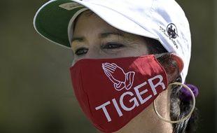 Une fan de Tiger Woods avec un masque affichant son soutien à la légende du golf, aux Etats-Unis le 28 février 2021.