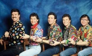 Framboisier (au centre) avec ses amis musiciens du groupe Les Musclés en 1990