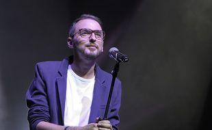 Christophe Willem lors d'un concert à l'Olympia pour l'association Les Voilà, le 13 octobre 2014.