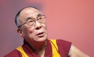 Le président George W. Bush a décidé de maintenir ses rencontres avec le dalaï-lama mardi et mercredi et d'apparaître pour la première fois en public à ses côtés, malgré les protestations de la Chine pour qui les Etats-Unis fortifient ainsi un indépendantiste en exil.