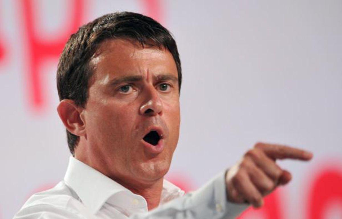 Le ministre de l'Intérieur, Manuel Valls, le 25 août 2012, à l'université d'été du PS à La Rochelle (Charente-Maritime). – P.ANDRIEU / AFP