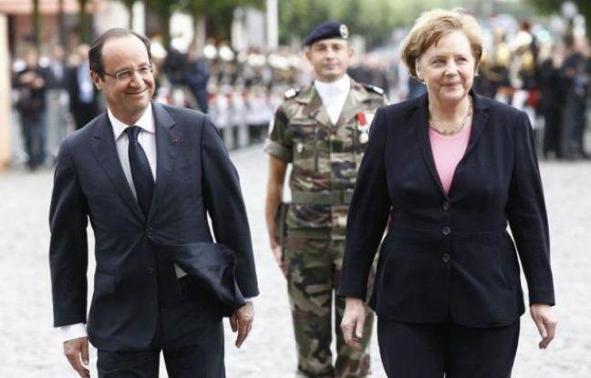 François Hollande et Angela Merkel ont célébré les 50 ans de la réconciliation franco-allemande à Reims, alors que l'Europe est en proie à une grave crise qui atteint le couple franco-allemand, moteur historique de la construction européenne.