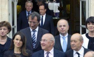 François Hollande et Jean-Marc Ayrault, rejoignent le gouvernement sur le perron de l'Elysée, le 17 mai 2012.