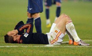 L'attaquant de l'Espagne, Fernando Torres, au sol lors d'un match de Coupe du monde contre le Chili, le 25 juin 2010 à Pretoria.