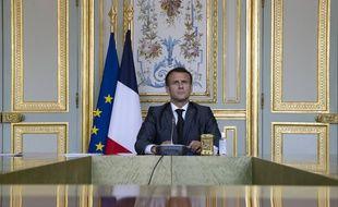 Le président français Emmanuel Macron assiste à une vidéoconférence au sommet sur le climat, à l'Elysée, à Paris, en France, le jeudi 22 avril 2021.