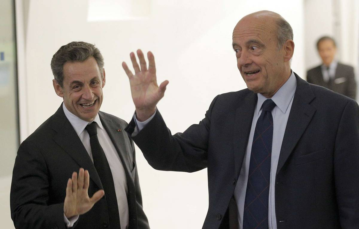 Nicolas Sarkozy et Alain Juppé, le 3 décembre 2014 à Paris. – Christophe Ena/AP/SIPA