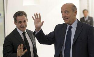 Nicolas Sarkozy et Alain Juppé, le 3 décembre 2014 à Paris.