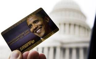 Commemorative Washington DC 'SmarTrip' Metro fare card with the image of U.S. President-elect Barack Obama's face is seen next to a bus window on the East side of the U.S. Capitol Building in Washington, January 13, 2009. The only other president to be honored this way on a Metro card was Bill Clinton in 1993.    REUTERS/Larry Downing  (UNITED STATES)