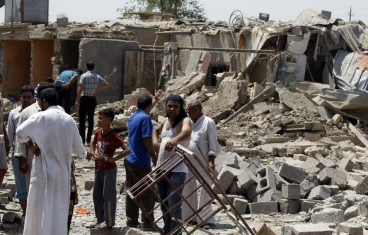 """L'Etat islamique d'Irak (ISI), branche d'Al-Qaïda, a revendiqué la vague d'attentats qui a fait 113 morts lundi, assurant qu'il s'agissait là du début de la nouvelle """"campagne militaire"""" lancée par son chef Abou Bakr al-Baghdadi. – Ahmad al-Rubaye afp.com"""