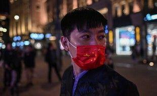 Un homme porte un masque à Shanghai  en ctbre 2020