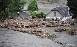 A Saint-Beat, des maisons submergées par les eaux dans des inondations sans précédent, le 19 juin 2013