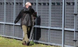 """Gilles Patron, """"père d'accueil"""" de Laetitia Perrais, arrive à la cour d'assises de Loire-Atlantique à Nantes, le 28 mars 2014"""