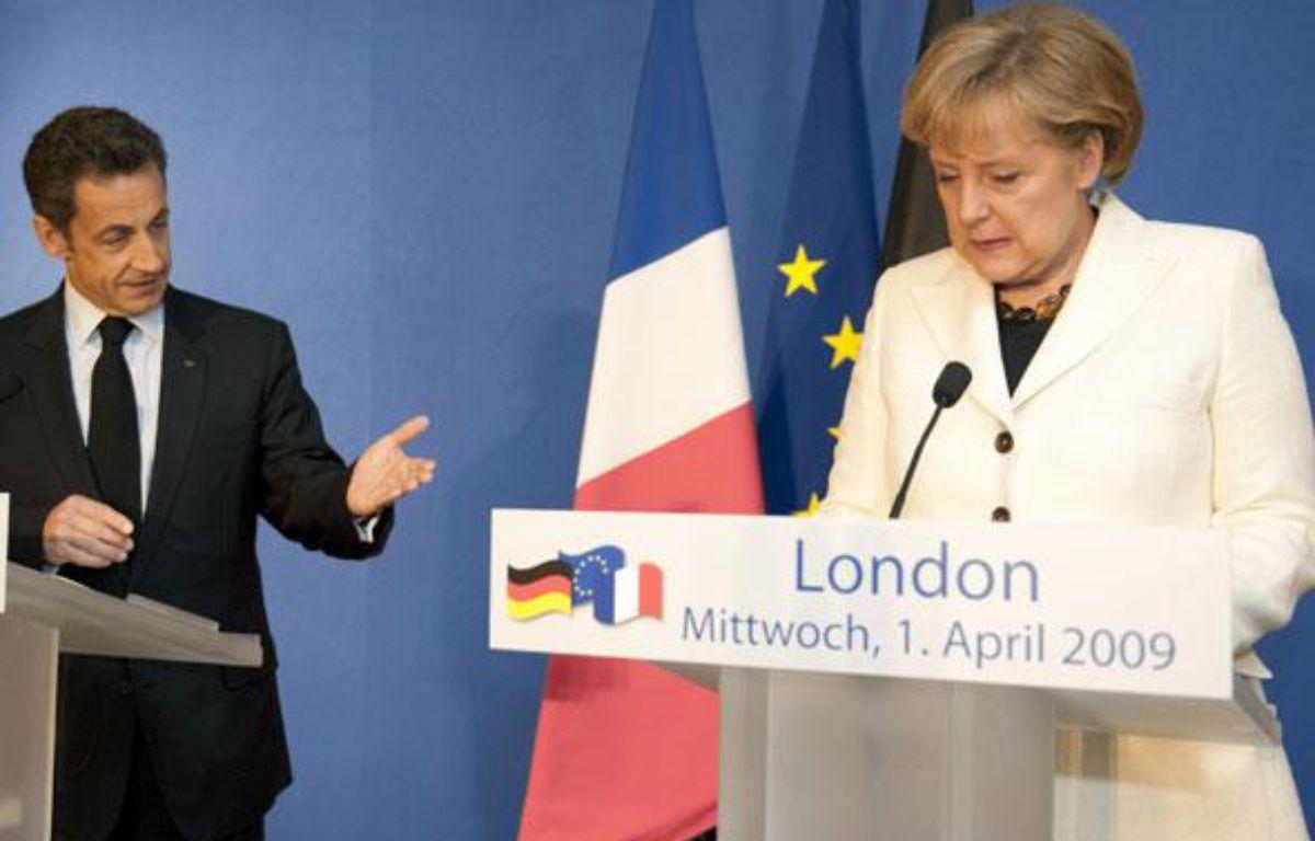 Nicolas Sarkozy et Angela Merkel, le 1er avril 2009 à Londres. – REUTERS/Philippe Wojazer