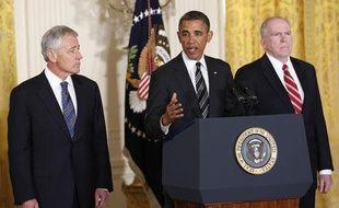 Le président américain Barack Obama (C) annonce la nomination de Chuck Hagel (G) au Pentagone et de John Brennan (D) à la CIA, à Washington le 7 janvier 2013.