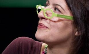 EELV national secretary Cecile Duflot wearing European Greens promotional cardboard glasses during the European Greens Congress on November 12, 2011 in Paris. AFP PHOTO JOEL SAGET