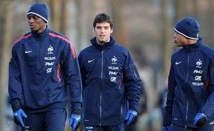 Yoann Gourcuff (au centre) et Abou Diaby (à gauche) en février 2011.
