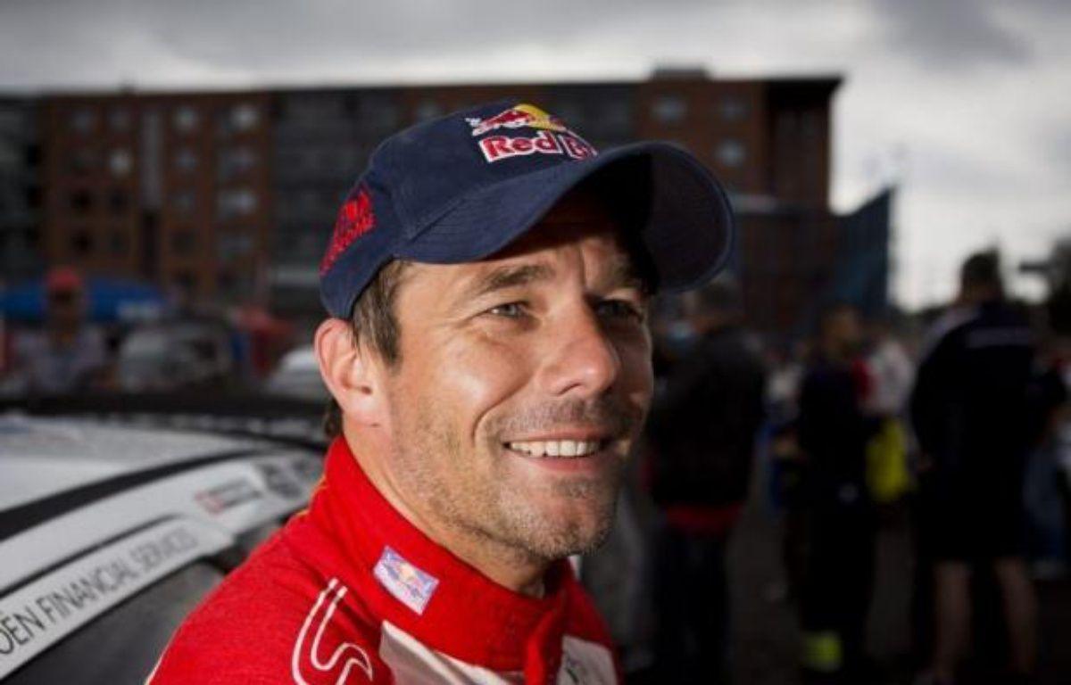 Le Français Sébastien Loeb (Citroën DS3) a remporté pour la neuvième fois de sa carrière le rallye d'Allemagne, 9e manche du championnat du monde WRC dimanche à Trèves (ouest) en devançant les Finlandais Jari-Matti Latvala (Ford Fiesta) et Mikko Hirvonen (Citroën DS3). – Roni Rekomaa afp.com