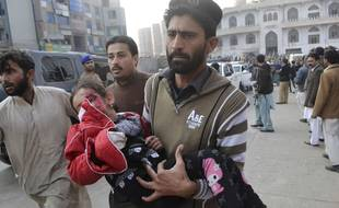 A Pakistani girl, who was injured in a Taliban attack in a school, is rushed to a hospital in Peshawar, Pakistan, Tuesday, Dec. 16, 2014. Taliban gunmen stormed a military-run school in the northwestern Pakistani city of Peshawar on Tuesday, killing and wounding scores, officials said, in the highest-profile militant attack to hit the troubled region in months.(AP Photo/Mohammad Sajjad)/XMM104/298303a831034c69b881a89a0cfec052-6b86acbe4b7a633168/1412161241