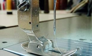 Une aiguille de machine à coudre (Illustration)