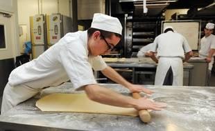 Un apprenti cuisinier.
