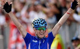 Le cycliste français Romain Sicard, vainqueur du titre de champion du monde de la course en ligne à Mendrisio, en Suisse, le 26 septembre 2009.