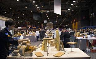 """Un artisan fromager participe le 24 février 2015 à Paris au concours de """"Meilleur ouvrier de France"""""""