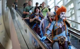 """A woman dressed as Voljin from the video game World of Warcraft rides an escalator at the BlizzCon, Friday, Nov. 6, 2015, in Anaheim, Calif. """"World of Warcraft"""" maker Blizzard is hosting its ninth annual fan-centric convention opening Friday. (AP Photo/Jae C. Hong)/CAJH118/449290986561/1511062253"""