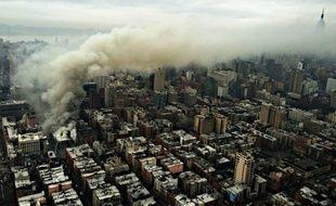 Un incendie dû au gaz a en partie détruit un immeuble de dans le quartier de East Village, à Manhattan, le 26 mars 2015.